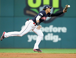 October 6, 2017 - Cleveland, Ohio, US - Cleveland Indians third baseman Erik Gonzalez snags a line drive by the New York Yankees' Greg Bird in the eighth inning during Game 2 of the American League Division Series, at Progressive Field in Cleveland. (Credit Image: © Phil Masturzo/TNS via ZUMA Wire)