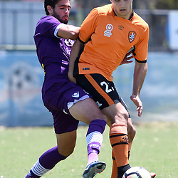 BRISBANE, AUSTRALIA - JANUARY 8: Nicholas D'Agostino of the Roar is tackled by Rhys Williams of the Glory during the round 8 Foxtel National Youth League match between the Brisbane Roar and Perth Glory at AJ Kelly Field on January 8, 2017 in Brisbane, Australia. (Photo by Patrick Kearney/Brisbane Roar)