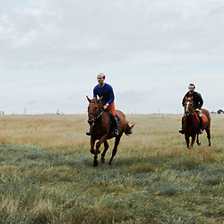 Brothers Xavier (left) and Nicolas Desforges, from Maison Caulieres, riding their horses. Dolus-le-Sec, France. October 7, 2019.