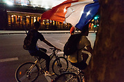 French nationals celebrate in the streets of Paris, as France beats Croatia in the World Cup Final. Paris, France.