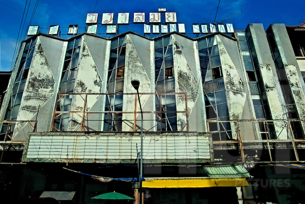 Frontage of the old Vieng Sabay cinema in Vientiane, Laos, Asia. This place is no longer projecting films and the building starts to be in serious decay.