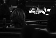 (081907  Dorchester, MA) A young boy comes up for air after crying on his father's shoulder during the funeral services for fallen soldier Joan Duran.