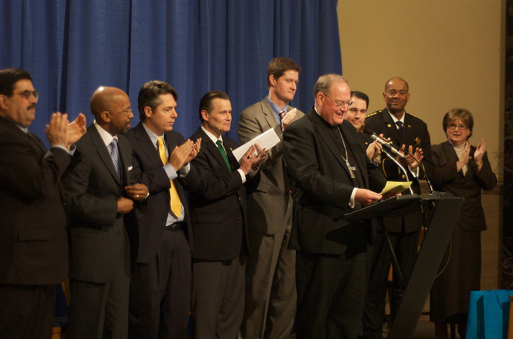 Archbishop Dolan receives a standing ovation before addressing the crowd at a farewell ceremony at City Hall, Tuesday March 31 2009.