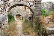 Arches vaults in the ruins that remain of the hilltop fortress tower. Pocitelj historic Muslim and Christian village near Mostar. Federation Bosne i Hercegovine. Bosnia Herzegovina, Europe.