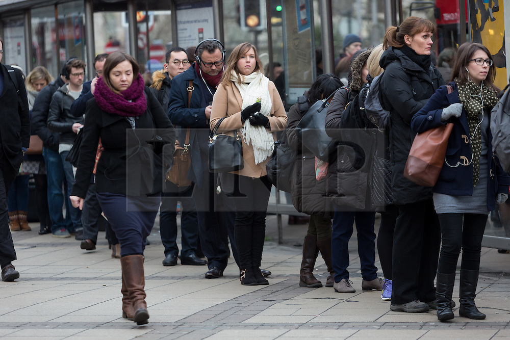 """© Licensed to London News Pictures. 18/01/2016. Commuters wait for busses at Waterloo station this morning. London, UK. Today, known as """"Blue Monday"""" is meant to be the most depressing day of the year. Photo credit : Vickie Flores/LNP"""
