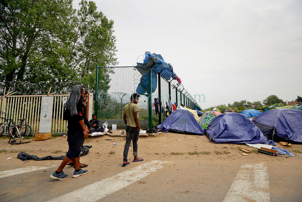 26 June 2020. Zone des Dunes, refugee camp, Calais, France.<br /> The Zone des Dunes refugee camp in Calais. Several tented refugee camps have cropped up to replace the notorious 'Jungle' camp which was dismantled by French authorities in October and November 2016. The Zone borders land where the Jungle once housed as many as 10,000 migrants desperately seeking any way possible to get to Britain. It is claimed that the Zone is controlled by Albanian criminal gangs exploiting migrants often paying as much as €5,000 to make the illegal crossing between France and Britain. Many migrants are now making desperate and dangerous attempts to cross the English Channel (La Manche) by boat, kayak, surf board and even inflatable paddling pools as numbers seeking asylum in the UK continue to rise. <br /> Photo©; Charlie Varley/varleypix.com