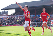 Cauley Woodrow of Barnsley (9) scores a penalty kick and celebrates to make the score 1-0 during the EFL Sky Bet League 1 match between Barnsley and Wycombe Wanderers at Oakwell, Barnsley, England on 16 February 2019.
