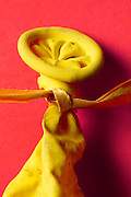close up of the knot in a deflated balloon with string
