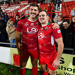 11th November 2018 , Racecourse Ground,  Wrexham, Wales ;  Rugby League World Cup Qualifier,Wales v Ireland ; Morgan Evans and Steve Parry of Wales celebrate after there victory over Ireland<br /> <br /> <br /> Credit:   Craig Thomas/Replay Images
