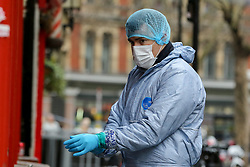 © Licensed to London News Pictures. 03/03/2019. London, UK. A forensic officer at the crime scene outside The Coach and Horses pub in Romilly Street in Soho. According to the police, a man aged 30 yrs old is seriously injured in hospital and a woman has been arrested. Photo credit: Dinendra Haria/LNP