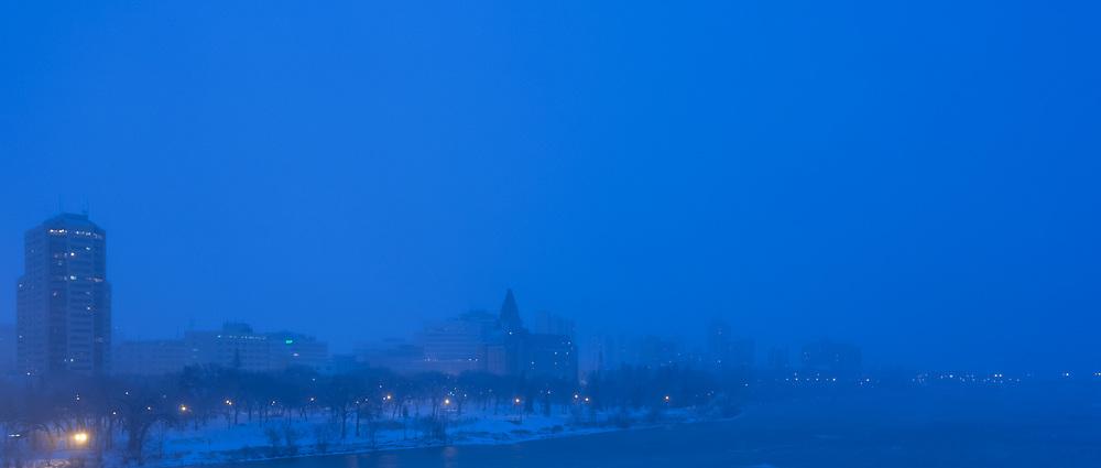 "Blue Night, Snow Warning, Saskatoon. 10"" x 20"" photograph on paper, framed."