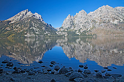 """Jenny Lake Reflect the Grand Tetons. Jenny is one of the Glacial Moraine Lakes that line the foot of the Grand Tetons in Grand Teton National Park.<br /> <br /> For production prints or stock photos click the Purchase Print/License Photo Button in upper Right; for Fine Art """"Custom Prints"""" contact Daryl - 208-709-3250 or dh@greater-yellowstone.com"""
