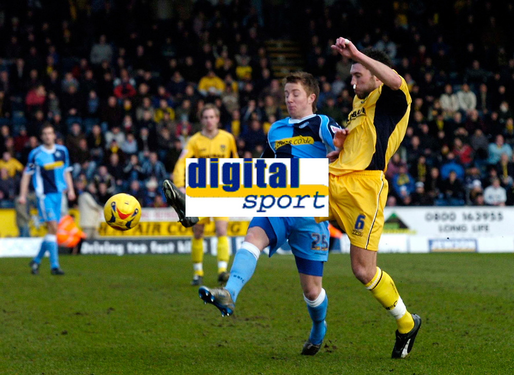 Photo: Richard Lane.<br />Wycombe Wanderers v Oxford United. Coca Cola League 2. 25/02/2006. <br />Wycombe's Dean Bowditch (L) is tackled by Oxford's Jon Ashton.