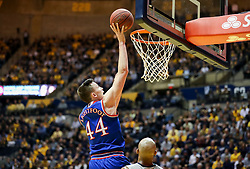 Jan 15, 2018; Morgantown, WV, USA; Kansas Jayhawks forward Mitch Lightfoot (44) shoots in the lane during the first half against the West Virginia Mountaineers at WVU Coliseum. Mandatory Credit: Ben Queen-USA TODAY Sports