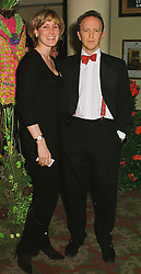 MR & MRS SIMON SEBAG-MONTEFIORE, she was Santa Palmer-Tomkinson a family friend of the Prince of Wales, at a party in London on 22nd February 1999.<br /> MON 110