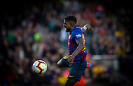 Umtiti of Barcelona,heads the ball in the air during the Spanish league football match of 'La Liga'  FC BARCELONA against RAYO VALLECANO at Camp Nou Stadium of Barcelona on March 9,2019