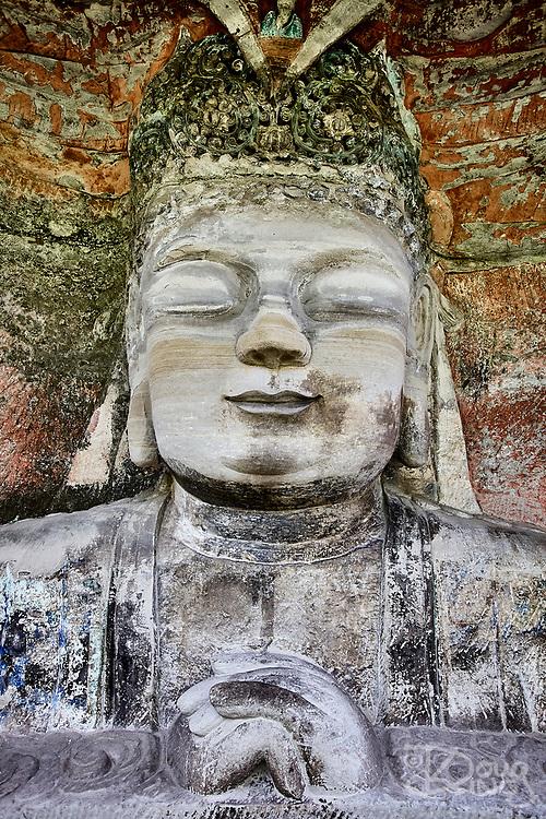 A statue of Buddha hewn from the cliffs at Dazu, Chongqing province, China.