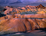 CADDV_010 -  Sunrise light on eroded mudstone which forms undulating hills, view west from Zabriskie Point, Death Valley National Park, California, USA