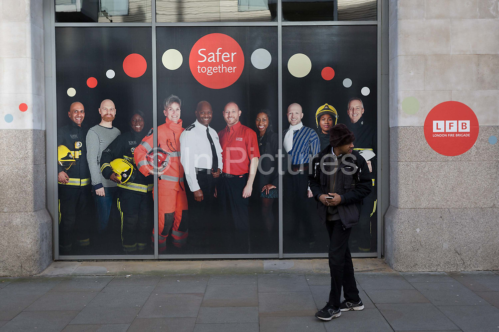 A poster featuring staff with the London Fire Brigade LFB outside their headquarters in Southwark, on 30th January 2018, in London, England.