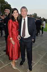 STEPHEN QUINN and his wife KIMBERLY at a party hosed by the US Ambassador to the UK Matthew Barzun, his wife Brooke Barzun and editor of UK Vogue Alexandra Shulman in association with J Crew to celebrate London Fashion Week held at Winfield House, Regent's Park, London on 16th September 2014.