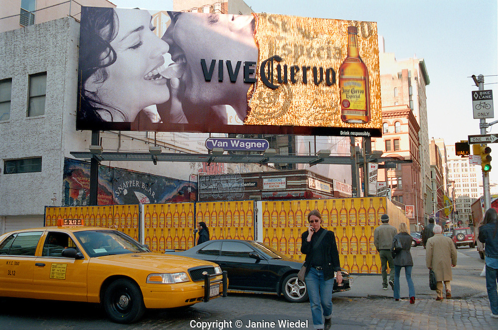 New York City street scene with billboard ads for drink.