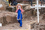 A young child dressed in a Chucky costume roams through the cemetery during  Day of the Dead festival October 31, 2017 in Tzintzuntzan, Michoacan, Mexico.