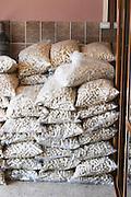 Sacks of cork piled in a corner. Kantina Miqesia or Medaur winery, Koplik. Albania, Balkan, Europe.