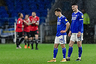 Cardiff City Mark Harris and Cardiff City Kieffer Moore look dejected after a Chris Willock of Queens Park Rangers goal during the EFL Sky Bet Championship match between Cardiff City and Queens Park Rangers at the Cardiff City Stadium, Cardiff, Wales on 20 January 2021.