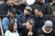 Leonardo DiCaprio keeps a low profile in flat cap and shades as he watches the French Open... amid claims he is 'seriously dating' British model Roxy Horner<br /> ©Exclusivepix Media