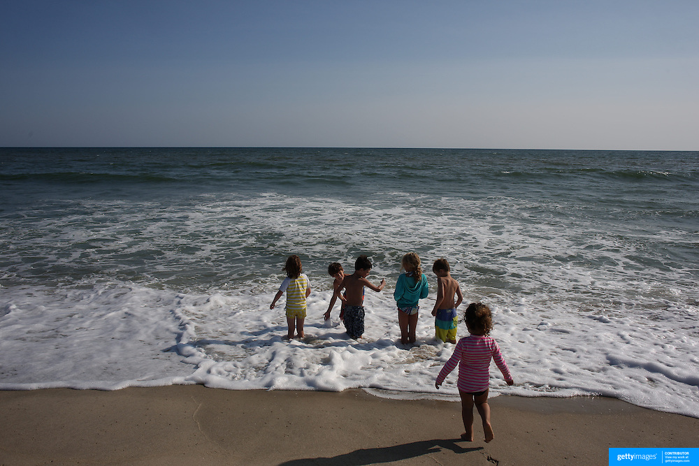 Youngsters on the waters edge in a beach scene in the height of summer on Cisco Beach, Nantucket, Nantucket Island, Massachusetts, USA. Photo Tim Clayton