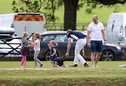 Prince William arrives to play at the Gloucestershire Polo Festival at the Beaufort polo club in Gloucestershire.<br /> <br /> When he arrived he chased Zara Tindall's daughter Mia who ran away from him.<br />