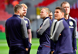 Burnley's players including Scott Arfield (centre) inspect the pitch before the game