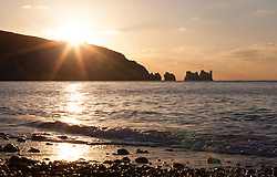 © Licensed to London News Pictures. 28/12/2014. Alum Bay, Isle of Wight, UK. Sunset this afternoon, 28th December 2014, over the Needles on the Isle of Wight. Temperatures  are set to drop overnight, which could possibility be the coldest night of the year so far. Photo credit : Rob Arnold/LNP
