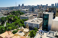 Azerbaijan, Baku. Baku city view. Flame Towers, a residential complex under construction in the background. St. Gregory the Illuminator's Church in the foreground.