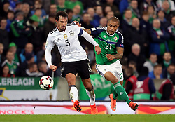 Northern Ireland's Josh Magennis and Germany's Mats Hummels (left) during the 2018 FIFA World Cup Qualifying, Group C match at Windsor Park, Belfast.