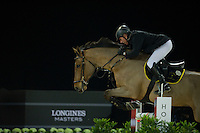 John Whitaker on Lord of Arabia competes during the Hong Kong Jockey Club Trophy at the Longines Masters of Hong Kong on 19 February 2016 at the Asia World Expo in Hong Kong, China. Photo by Juan Manuel Serrano / Power Sport Images