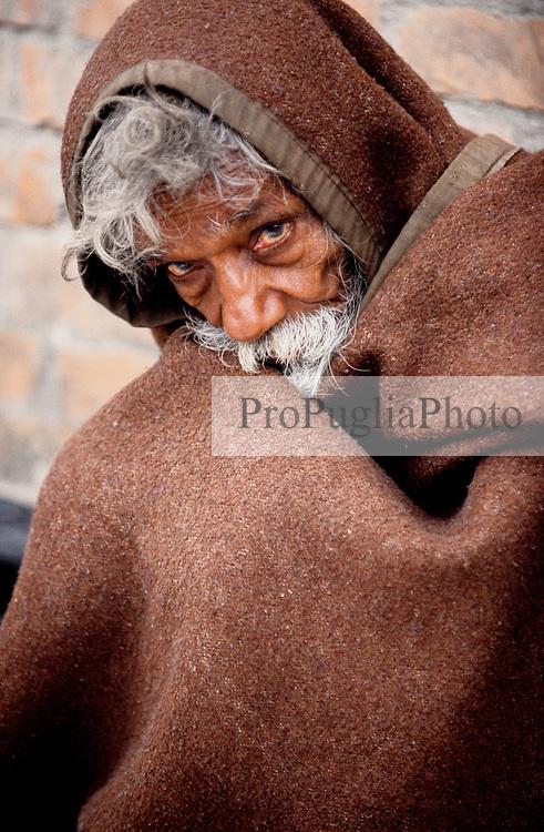 Kathmandu, 20 February 2005.  An old man sitting on the pavement near Ratna park