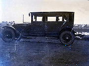 old damaged image of car 1920s