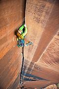 Pamela Shanti Pack on the Mayor 5.11++, Longs Canyon, AKA - Offwidth City, Moab, UT