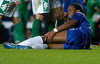 Photo: Leigh Quinnell.<br /> Chelsea v Real Betis. UEFA Champions League.<br /> 19/10/2005. Chelseas Didier Drogba in pain after a tackle.