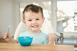 Portrait of boy eating pap