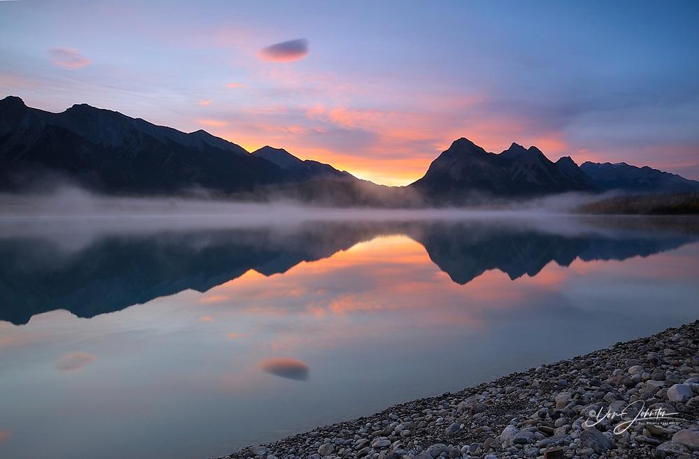 Sunrise skies and morning fog over Abraham Lake in autumn, Abraham Lake Recreation Area, AB, Canada