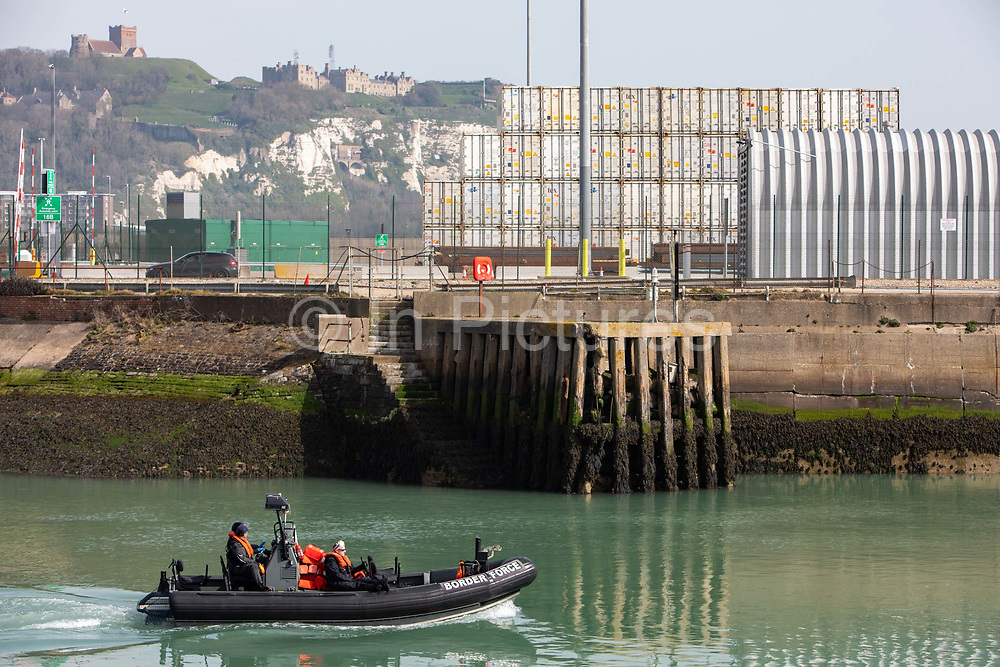 The Boarder Force RIB boat going out to collect asylum seekers  from a larger boat in the harbour they had rescued in the English Channel while crossing in small inflatable dinghy on the 31st of March 2021 in Dover, Kent, United Kingdom. About 30 men and women arrived today on two small boats they were taken off the boat by UK Boarder Force and taken into a processing centre on the dock side.