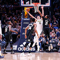 01 April 2018: Denver Nuggets center Nikola Jokic (15) goes for the reverse layup past Milwaukee Bucks center John Henson (31) during the Denver Nuggets 128-125 victory over the Milwaukee Bucks, at the Pepsi Center, Denver, Colorado, USA.