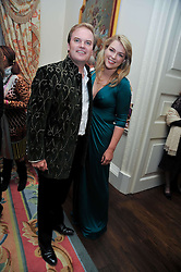 LORD & LADY DALMENY at a party to celebrate the publication of Gosling - Classic Design for Contemporary Interiors by Tim Gosling held at William Kent House, The Ritz Hotel, London on 1st October 2009.
