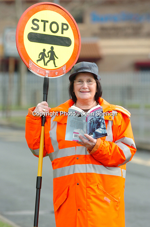 23 February 2007: Reading club for staff at Holy Name Primary School, Hull.<br /> Lollipop lady Audrey James.<br /> Picture:Sean Spencer/Hull News & Pictures 01482 210267/07976 433960<br /> High resolution picture library at http://www.hullnews.co.uk<br /> ©Sean Spencer/Hull News & Pictures Ltd