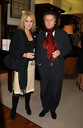 Actress JOANNA LUMLEY and her husband MR STEPHEN BARLOW at a party to celebrate the launch of The Monneypenny Diaries at Smythson, 40 New Bond Street, London W1 on 4th October 2005.<br /><br />NON EXCLUSIVE - WORLD RIGHTS