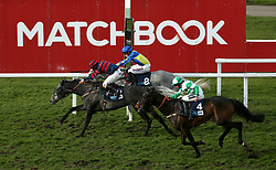 Misty Whisky ridden by Sean Bowen (left) leads to win against Silver Forever ridden by Harry Cobden (centre) and Farne ridden by Bryony Frost in the BF Stallions/TBA Mares' Standard Open National Hunt Flat Race at Sandown Park Racecourse, Esher.