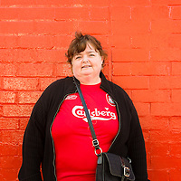 Anfield, Liverpool, UK. 15th April, 2014. Katherine, a local woman, attends the Hillsborough service at Anfield Statdium. She comes every year. She knew people who survived the tragedy at Hillsborough 25 years ago.