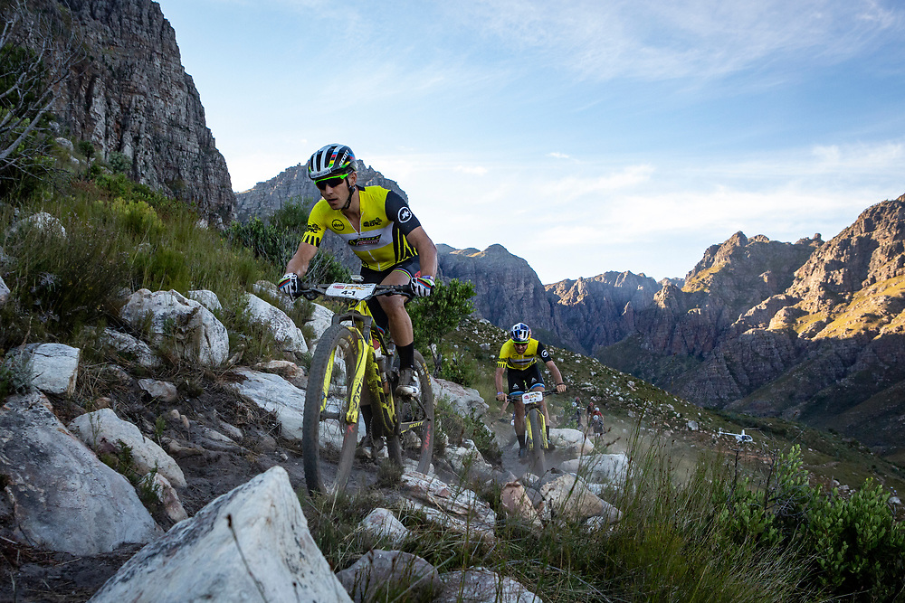 Nino Schurter and Lars Forster of SCOTT SRAM during stage 6 of the 2019 Absa Cape Epic Mountain Bike stage race from the University of Stellenbosch Sports Fields in Stellenbosch, South Africa on the 23rd March 2019<br /> <br /> Photo by Nick Muzik/Cape Epic<br /> <br /> PLEASE ENSURE THE APPROPRIATE CREDIT IS GIVEN TO THE PHOTOGRAPHER AND ABSA CAPE EPIC